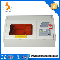 Low Price small crafts fabric laser carving cutting machine