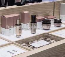 Cosmetics shop perfume glass display showcase and skincare products stand