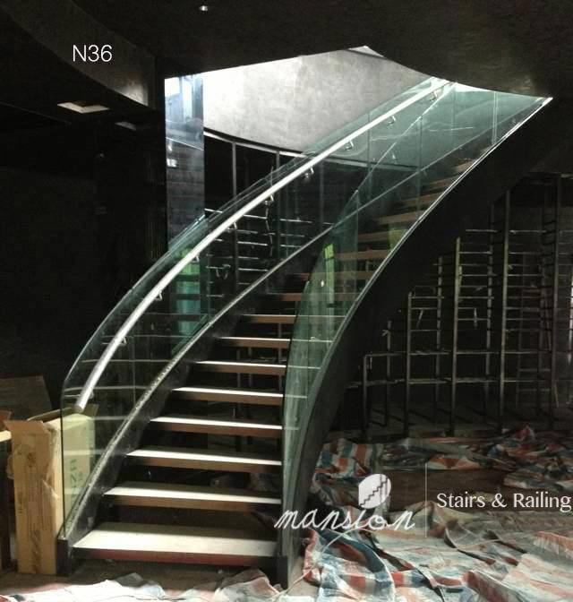 Curved Glass Railing Wood Stairs
