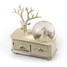 Ivory Wedding Couple Musical Custom Snow Globe atop of a Silver Accented Commode with 18 Note Tune
