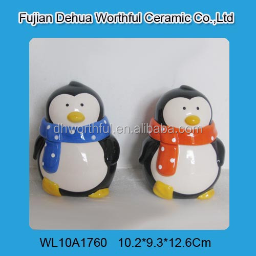 Decorative penguin shaped ceramic kitchen canisters