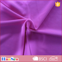 Weft knitted semi-dull cotton-like polyester spandex plain sports wear fabric