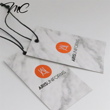 China Custom Red Copper Foiling Printing Fancy Recycle Paper Clothing Hang Tag with black wax string