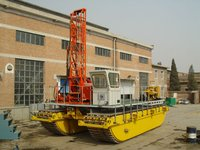 Marsh seismic shothole drill rig