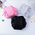 Wholesale lazy man's make-up bag has large capacity and portable drawstring make-up bag