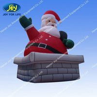 Life-Sized Inflatable Santa Hanging From the Gutter Christmas Decoration
