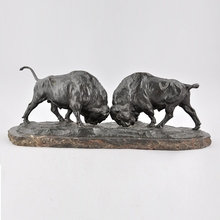 large outdoor bronze bull sculpture of two fighting bison