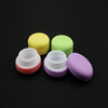 colored food macaron style lip balm container
