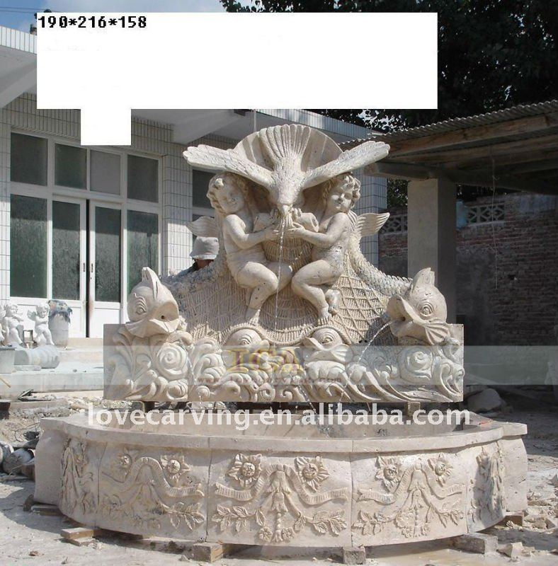 Big garden yellow stone wall fountain with eagle