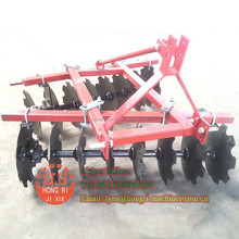 Agricultural equipment tractor farm harrow in plowing machine