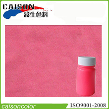 Fluorescent pink pigment colors for textiles one-bath dyeing