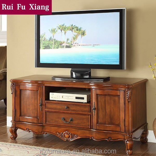 Wooden tv stand with hand carved pattern and drawer for