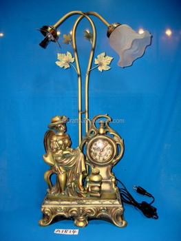 Table lamp and clock with polyresin figure base