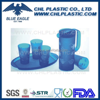 Transparent plastic pitcher with 4 cups and tray