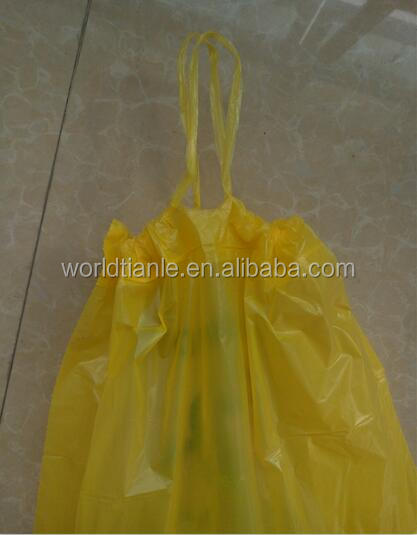 Big yellow/clear plastic drawstring garbage bag with PE tape