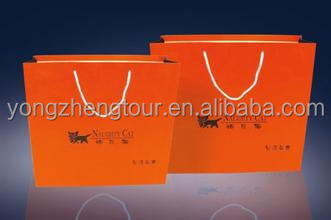 Orange color shopping paper bag with print