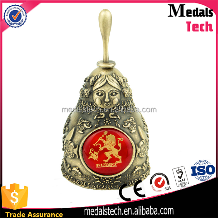 OEM customized metal crafts Poland religion souvenir dinner bell with sticker logo