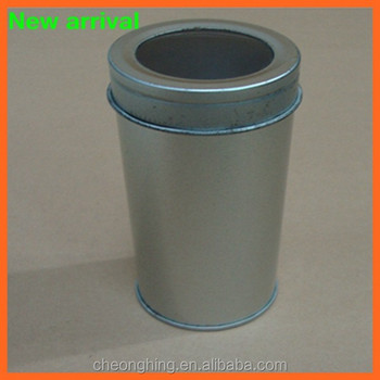 Empty small round tin can with pvc window