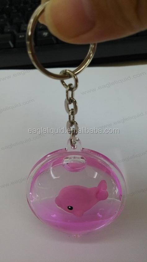 oil liquid keychain with pink dolphin floater