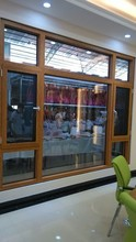 German style wood window with aluminum cladding open inward- flying screen