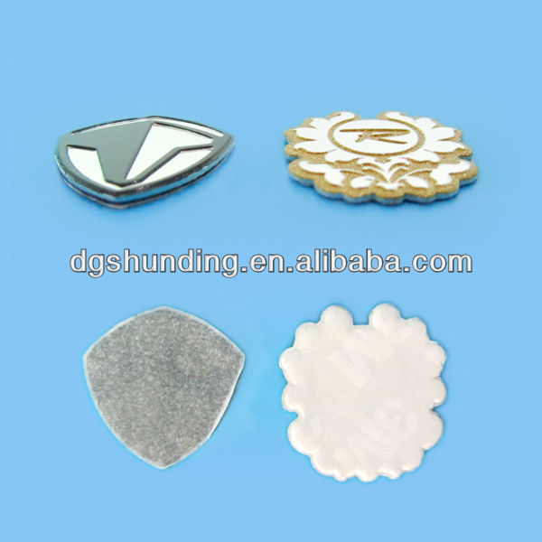 gear shape embossed/stamped metal badge with silkscreened on embossed logo