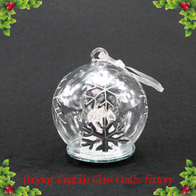 Glass angel in clear glass ball with color light for Christmas decoration