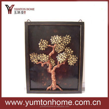 Antique metal wall decor with golden tree design