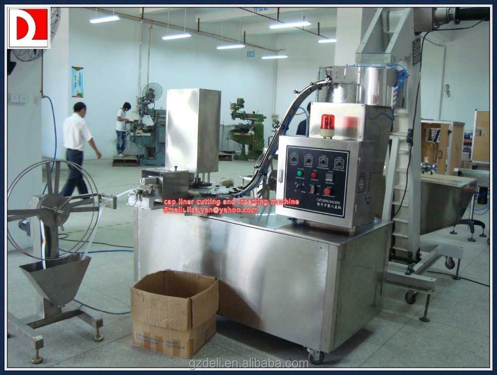 Automatic cap lining inserting machine