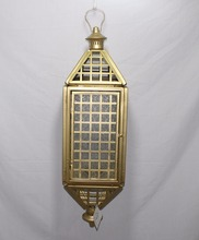 Modern bright golden moroccan hanging lantern with glass