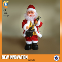 12 inch Dancing Santa plays Guitar