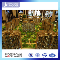 Architectural model with tiny house , commercial model and villa house for real estate .