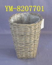 Plastic lined wicker basket for plants