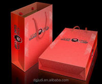 Medium & Small Red Paper Gift Bag with gold twist handle