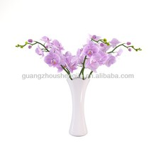 Sleek realistic artificial flower orchid in vase