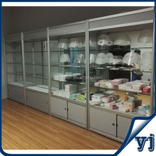 Guangzhou supplier assembled facial mask and beauty products glass cabinet display with mirror backboard