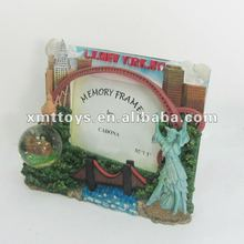 resin photo frame with building and fruit around