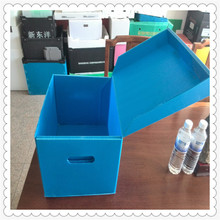 Folding corrugated plastic packing box with lids