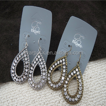 silver grey light grey earring card with logo white writing