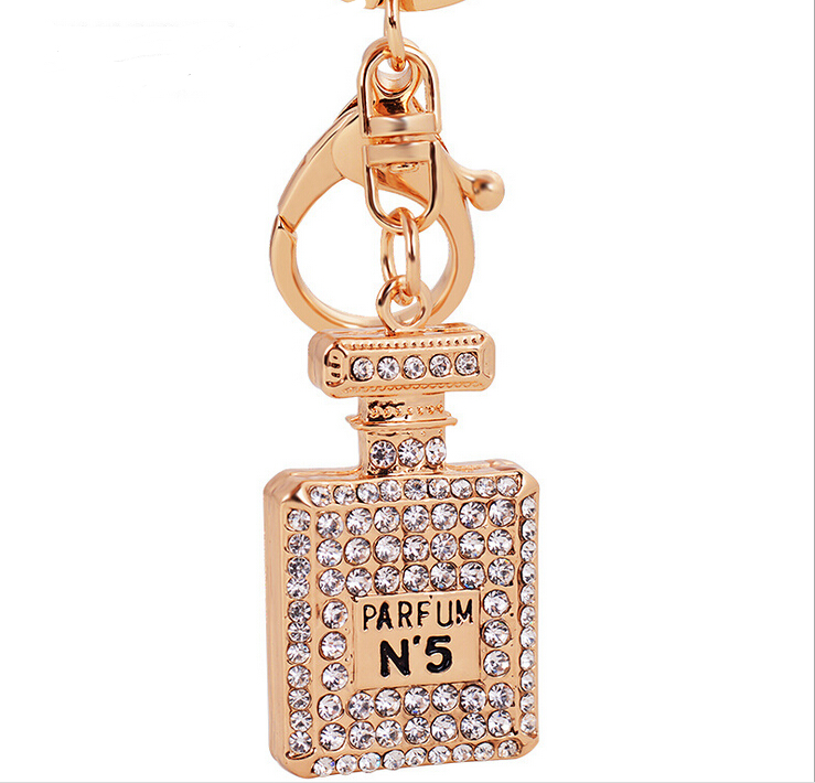 wholesale custom keychains delicate women gold plated metal rhinestone perfume bottle keychain
