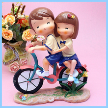 Custom high quality resin Anime/Cartoon boy ride bike with girl figures statues for love,wedding decor