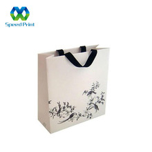 Unique design art picture bamboo printed retail door gift paper bag design with black ribbon