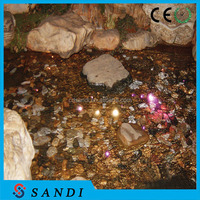 Solid core end emitting fiber optic outdoor lighting for pond light