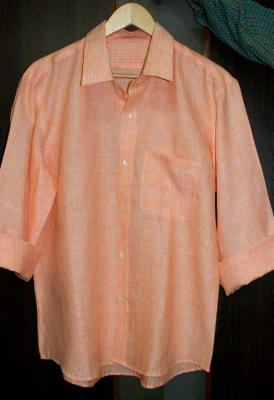 Orange casual linen shirt with mother of pearl buttons