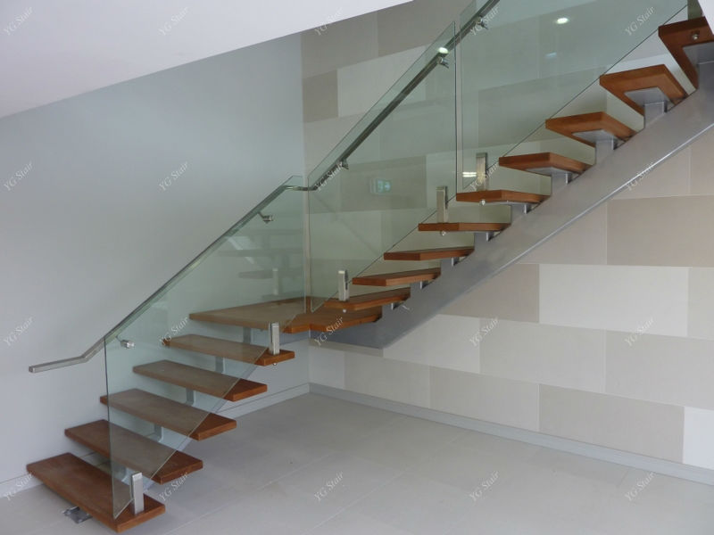 Modern indoor stairway with glass railing