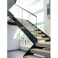 interior L shape steel stringers stairs with rubber wood treads and frameless glass railings