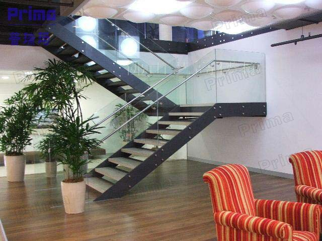 Modern open stairs with double steel stringer and glass railing