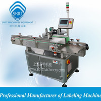 Automatic electronic cigarette small bottle labeling machine 0086-18917387699