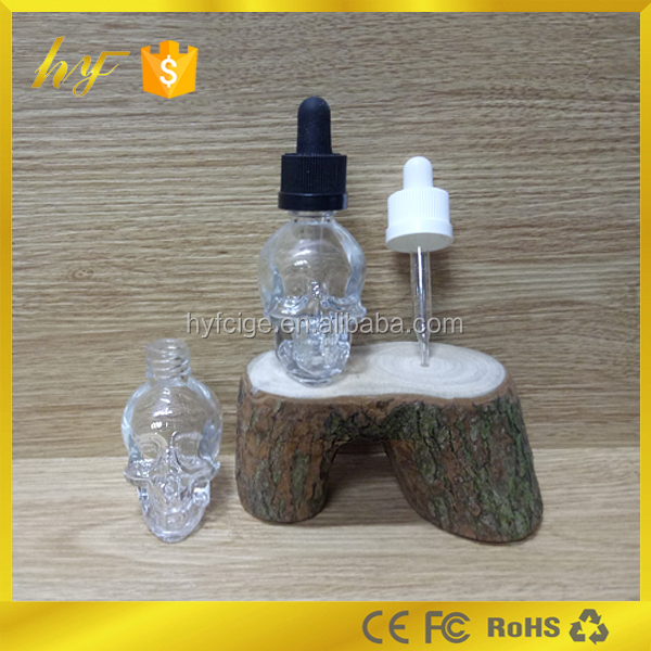 special price unique glass bottle 30ml skull head bottle and empty beverage &cocktail bottle wholesale