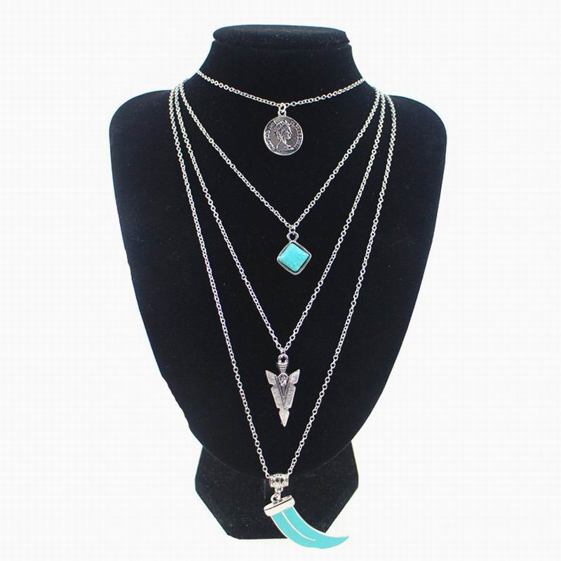 The new multi-level jewelry turquoise tassel necklace pendant Spike Bohemian long sweater chain