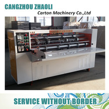 Semi automatic corrugated board slitting and creasing machine with manual feeder